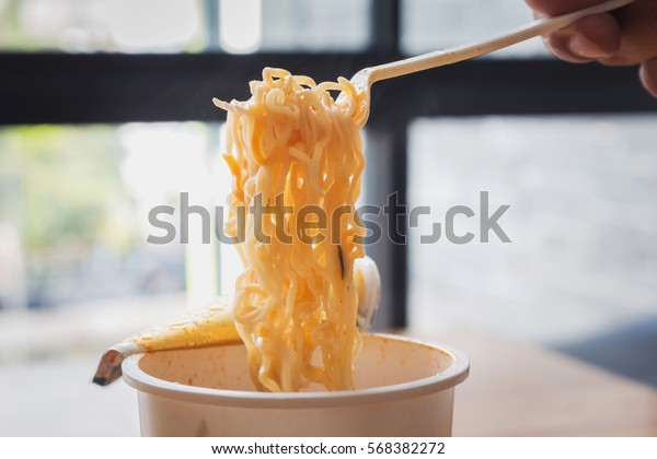Eating Instant Noodles with a Plastic Fork