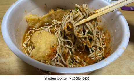 Eating instant noodles and tempura soba. Using chopsticks.Japanese food culture using chopsticks.