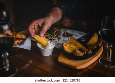 Eating and leisure concept. Enjoying dinner. People having dinner on the table. Assorted delicious vegetables with grilled meat. Toned image. Selective focus.