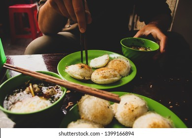 Eating a popular vietnamese breakfast food called banh can nha chung (quail eggs with meatball soup)