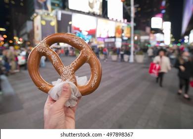 Eating Pretzel fast food in New York City.