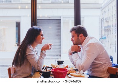 eating in restaurant, happy smiling couple having lunch in cafe, dating