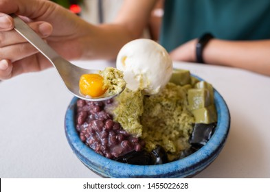 eating shaved ice with colorful dessert, famous Taiwanese snacks at Taiwan
