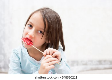 eating sugar candy, colored lollipop