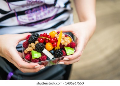 Eating various colorful wild berries like raspberry, blueberry, redcurrant, white currant, and blackberry