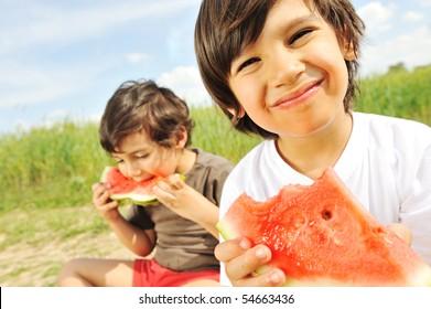 Eating watermelon outside
