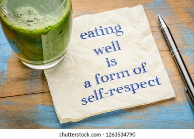 eating well is a form of self-respect - handwriting on a napkin with a glass of fresh, green, vegetable juice