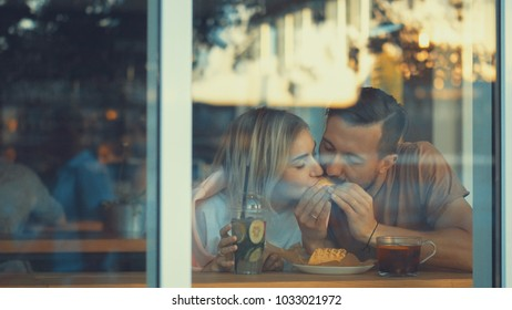 Eating young couple in a cafe