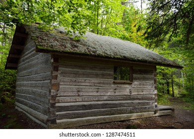 Eau Claire, Calvin, Ontario, Canada - September 19, 2014: Moss covered roof of historic log cabin at Eau Claire Gorge Conservation Area on forest trail