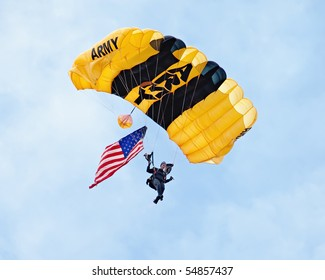 EAU CLAIRE, WI - JUNE 6: A closeup of a member of the U.S. Army Golden Knights parachute team on her descent with a United States flag at the Chippewa Valley Airshow in Eau Claire, WI on June 6, 2010.