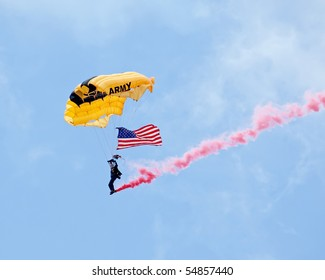EAU CLAIRE, WI - JUNE 6: A member of the U.S. Army Golden Knights parachute team on her descent with a United States flag at the Chippewa Valley Airshow in Eau Claire, WI on June 6, 2010.