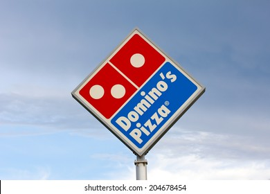EAU CLAIRE, WI/USA - JUNE 24, 2014:  Domino's Pizza restaurant sign. Domino's is the second-largest pizza chain in the United States and the largest worldwide.