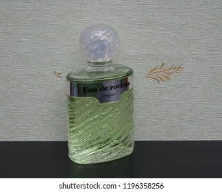 Eau de Rochas big perfume bottle in front of the satin wallcovering Elysee Kassel, Germany, 09.15, 2018 : Rochas is a French perfume provider from Paris This women's fragrance was designed by G.Robert