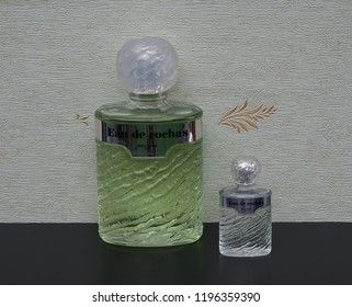 Eau de Rochas fragrance for ladies big  perfume bottle next to a commercial perfume bottle in front of the satin wallcovering Elysee Kassel Germany 09.15, 2018 Rochas is a French perfume provider