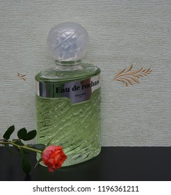 Eau de Rochas fragrance for ladies big perfume bottle in front of the satin wallcovering Elysee decorated with a rose Kassel Germany 09.15, 2018 Rochas is a French perfume provider from Paris.