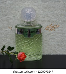 Eau de Rochas fragrance for ladies big perfume bottle in front of the satin wallcovering Elysee decorated with a rose Kassel, Germany, 09.15, 2018 Rochas is a French perfume provider from Paris