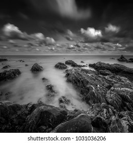 eautiful long exposure shot of seascape in black and white. Soft focus due to long exposure shot. Nature composition.