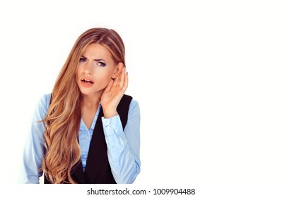 Eavesdropping, hearing bad news. Frustrated unhappy woman listening ear to bad news or having hearing impair hard of hearing pretty girl isolated on white background wall