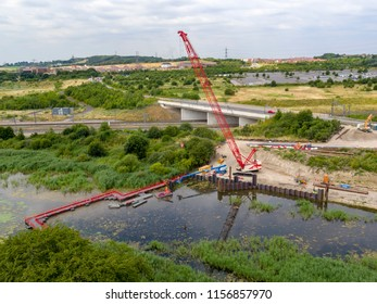 EBBSFLEET, KENT/ UK- JULY 09 2018: Work starts on the Springhead Bridge installation, that will link Springhead Park housing estate to Ebbsfleet International Train Station.