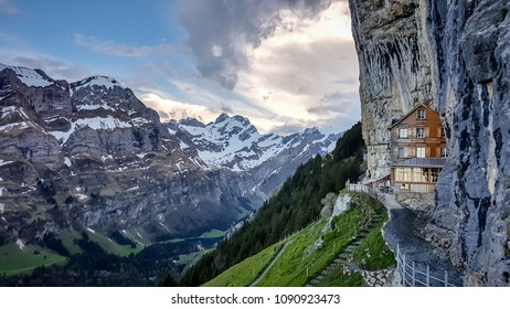 EBENALP, SWITZERLAND, May 2017: Ebenalp with its famous cliff inn Aescher. Ebenalp is an attractive recreation region for hiking, climbing, skiing and paragliding in Appenzell, Switzerland