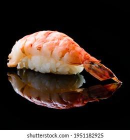 Ebi sushi, Japanese shrimp on Japanese rice.Japanese tradition food cuisine style with black isolated background. nigiri ebi sushi