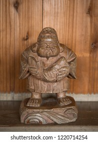 Ebisu statue of wood carving