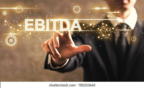 EBITDA text with businessman on dark vintage background