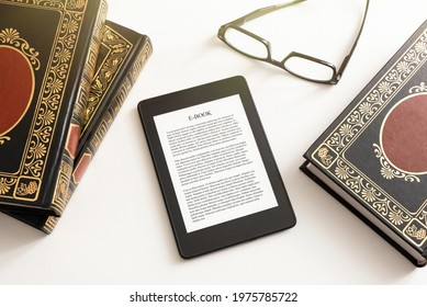 E-book reader with traditional books composition. Book reading with e-book device concept