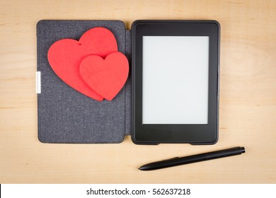 E-book reader with two red hearts and copy space on screen