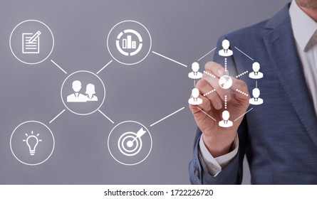 E-business concept. Unrecognizable entrepreneur touching white icons representing online business process on interactive screen, grey background