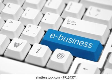e-business key on a white keyboard closeup. E-commerce concept image.