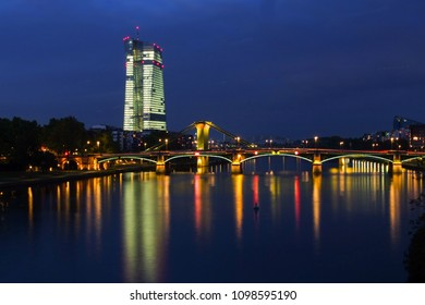 ECB-Building at night and Ignatz-Bubis-bridge over the river Main, Frankfurt, Germany, 2014
