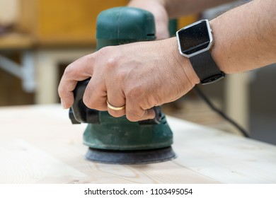 eccentric grinder with hand