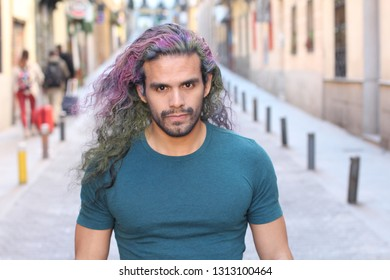 Eccentric man with long haired dyed hair