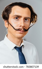 eccentric man with a long mustache in his shirt and tie. A mad office worker, a businessman, a student or an artist.