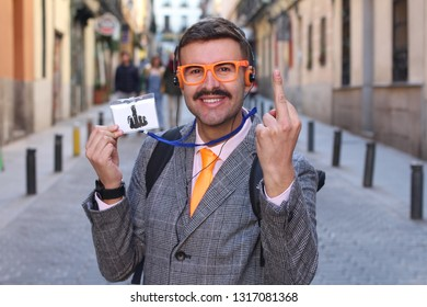 Eccentric retro styled businessman showing the middle finger