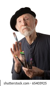 Eccentric senior artist with brushes wearing a beret