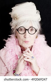 Eccentric senior woman with stylish look and great expression.