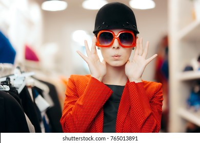 Eccentric Stylish Fashion Girl With Big Sunglasses and Chic Hat - Funny trendy woman wearing a red polka dots blazer and a riding style hat