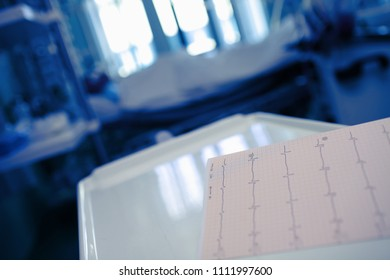 ECG chart on the desktor in the patient's room at the night.