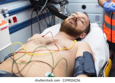 ecg electrodes on patient chest in ambulance