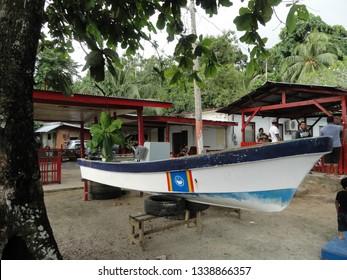 Echang, Palau - July 1, 2018. Boat with Tobi state emblem ashore.