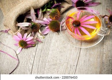 Echinacea purpurea. Cup of herbal echinacea tea on rustic wooden table