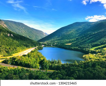 Echo Lake lies in Franconia Notch State Park located in the White Mountains of New Hampshire, at the foot of Cannon Mountain.Overlook the summer view from mountain.