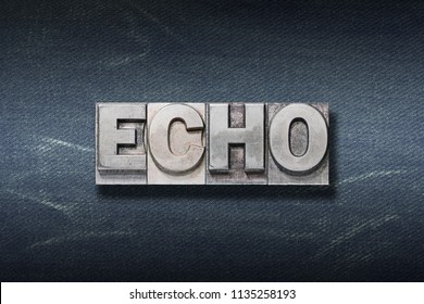 echo word made from metallic letterpress on dark jeans