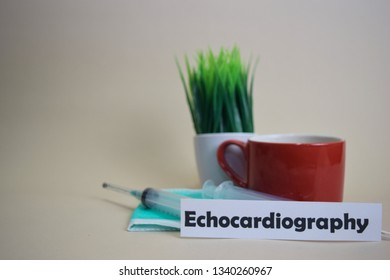 Echocardiography text, grass pot, coffee cup, syringe, and face green mask. Healtcare/Medical and Business concept