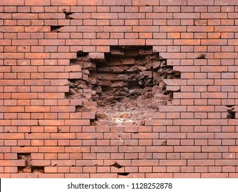 Echoes of war. Wall damaged by a military projectile (bomb), broken red brickwork. Brest fortress, exterior, fortification