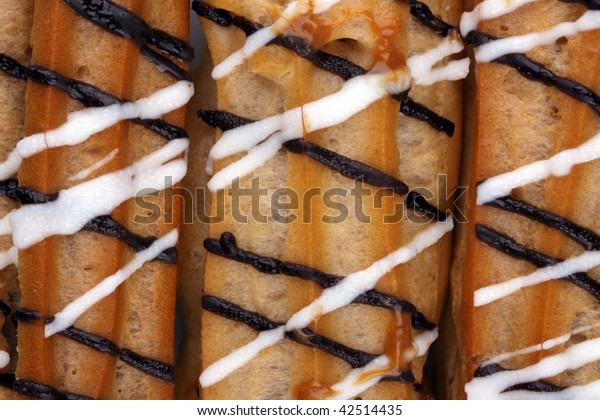 Eclairs with a chocolate cream stuffing can be used as background