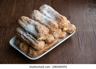 A lot of eclairs on the plate