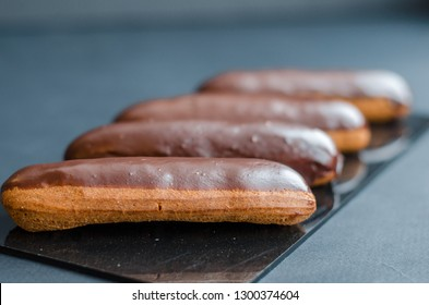 eclairs in a white box, delivery of eclairs, glazed eclairs, photos of eclairs close-up,eclairs with chocolate